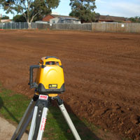 Synthetic turf laser levelling