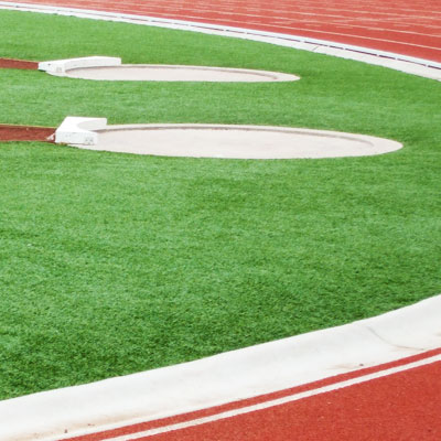 Synthetic grass for track and field
