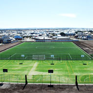 Synthetic grass construction for schools